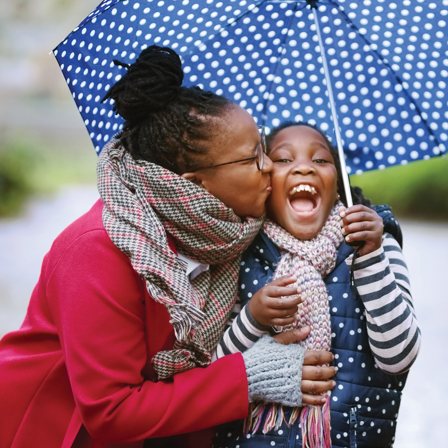 Two Black girls having fun in the rain